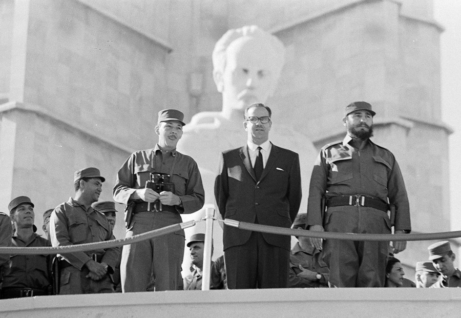 2 The Cuban Prime Minister Fidel Castro, President Osvaldo Dorticos and  Armed Forces Chief, Commander Raul Castro, watch as Cuban military units  7th anniversary of the overthrow of the Batista regime, January 2, 1966 - AP.jpg